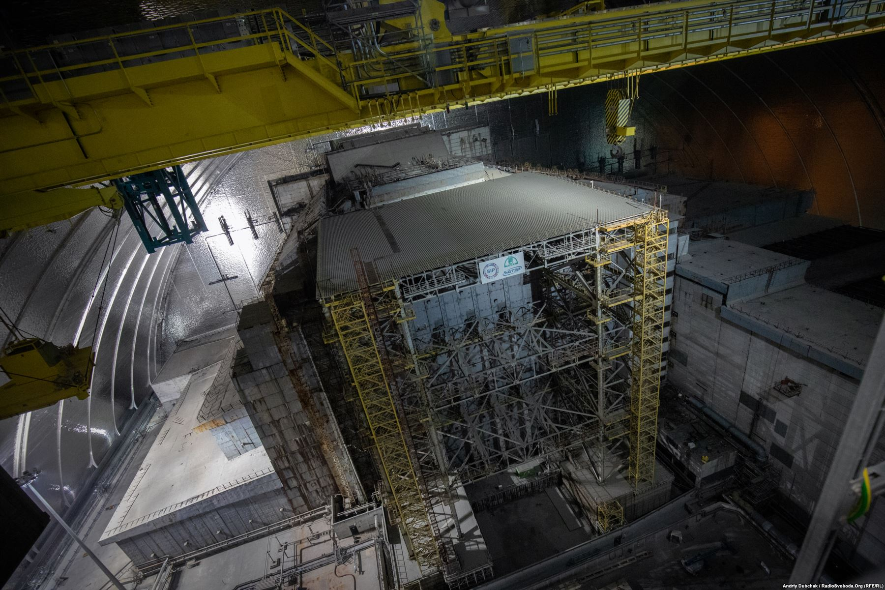 A new steel structure was built under the containment shield to support the decaying concrete sarcophagus in Chernobyl's reactor number four. Eventually, officials plan to dismantle the sarcophagus and remove the remaining nuclear fuel from the plant. Photo by: Andriy Dubchak