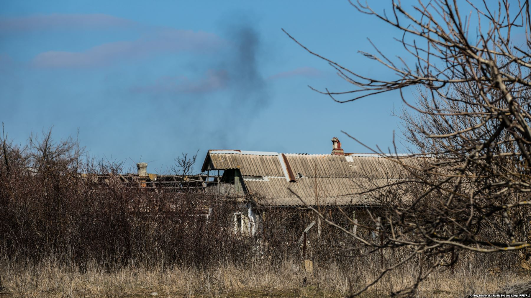 As RFE/RL photojournalist Andriy Dubchak walked through Vodyane on March 26, a series of explosions, followed by an intense burst of shooting broke out on the outskirts of the village. As Dubchak watched, this column of smoke drifted into the sky.