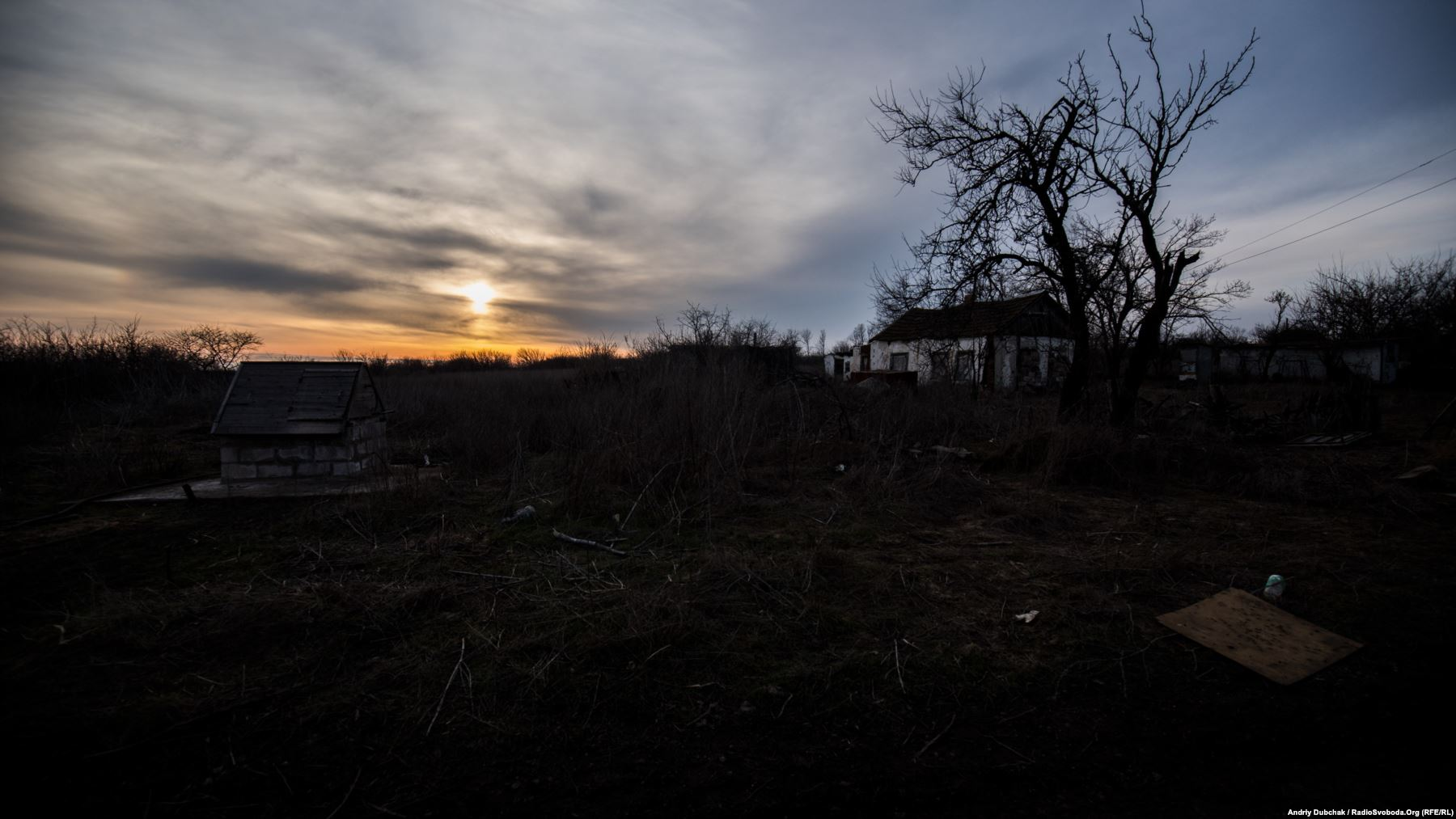 As the sun sets behind the village, fighters on both sides of the conflict prepare for the nightly firefights of a war that is fought largely after dark. The war between Russia-backed separatists and the Ukrainian military has raged for nearly four years and killed more than 10,000 people.
