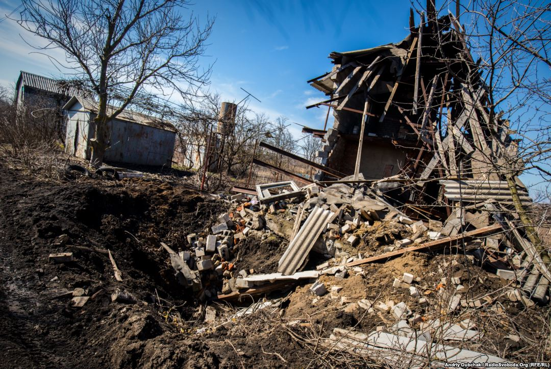 The remains of a dacha destroyed by a direct hit from a 152-mm artillery shell. Photo by: Andriy Dubchak