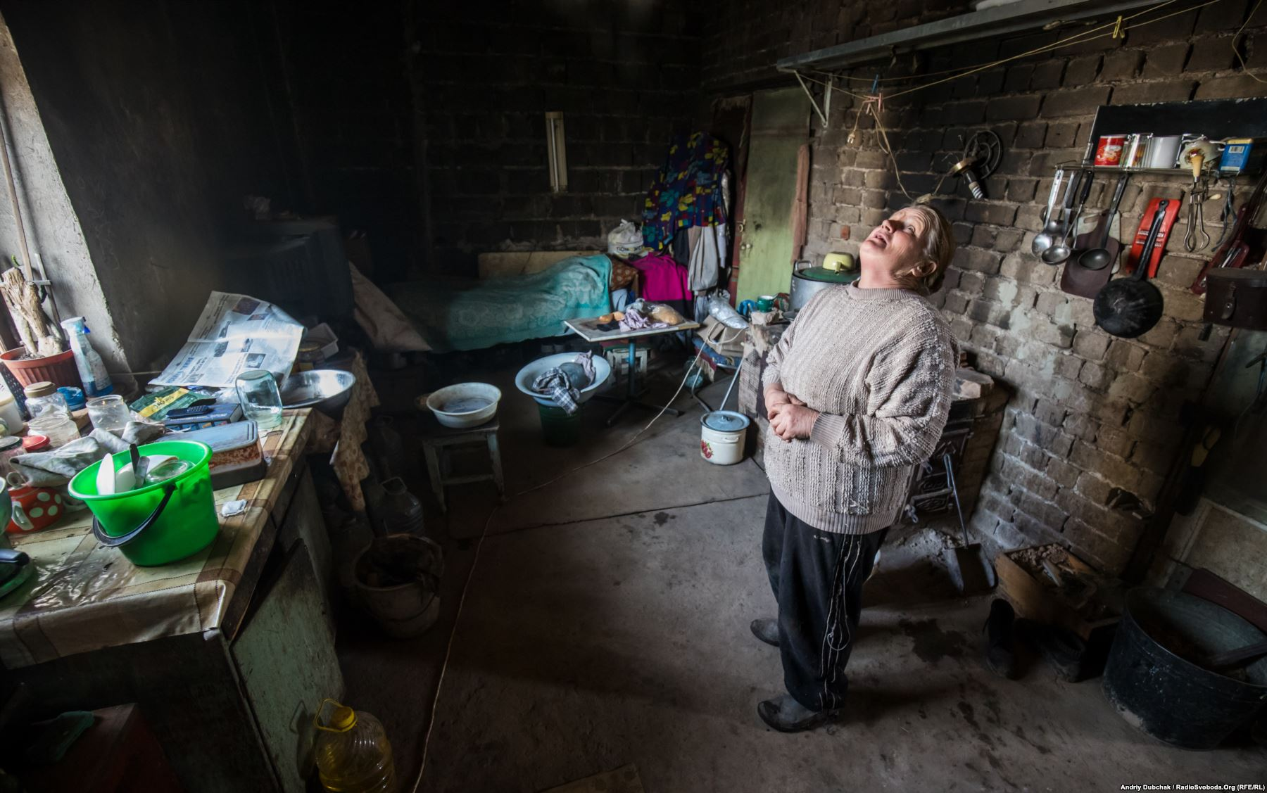 Zoya Kral lost her husband and son during the fighting. She now lives alone in Vodyane, surviving on handouts from the Ukrainian military and the Red Cross. Photo by: Andriy Dubchak