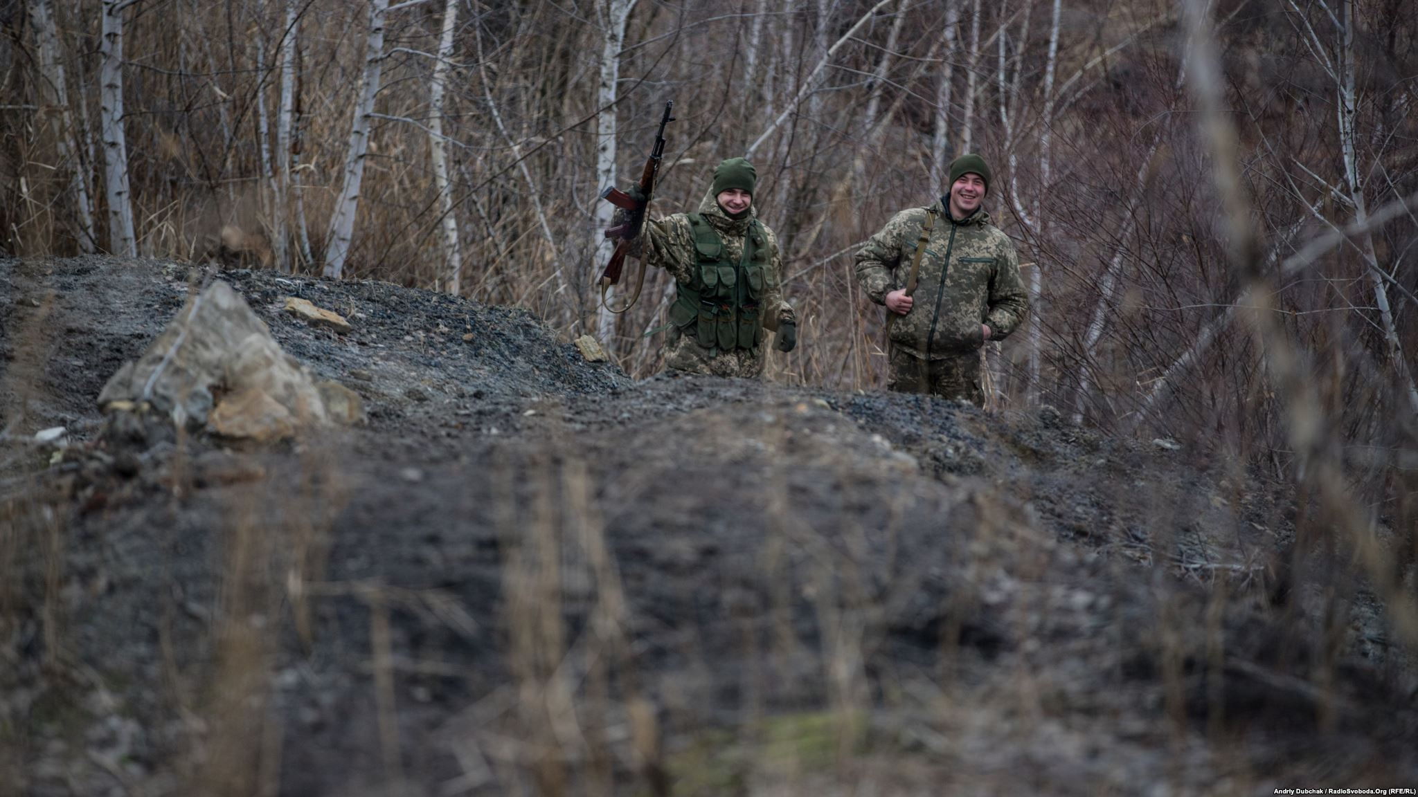 One of the flat areas of the descent from the slagheap . Guys were without ammunition and tripods, so they walked even faster. We continued to photograph them while they laughed and waved with their machineguns (photo by ukrainian military photographer Andriy Dubchak)