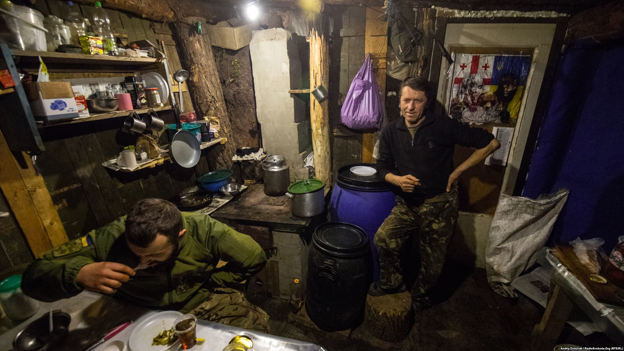 Kitchen- dining room. On the right, Doc, who is both a medic and a cook (photo by ukrainian military photographer Andriy Dubchak)