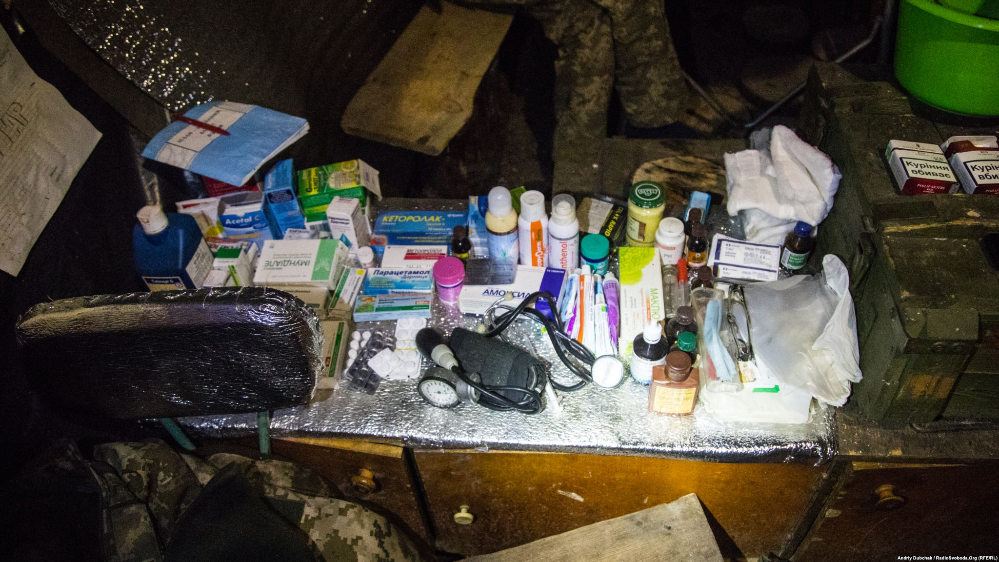 Medical supplies in a dugout-kitchen-sleeping room. Here is pretty much everything that needed - common cold-flu medicines and special medications for treating serious combat injuries (photo by ukrainian military photographer Andriy Dubchak)