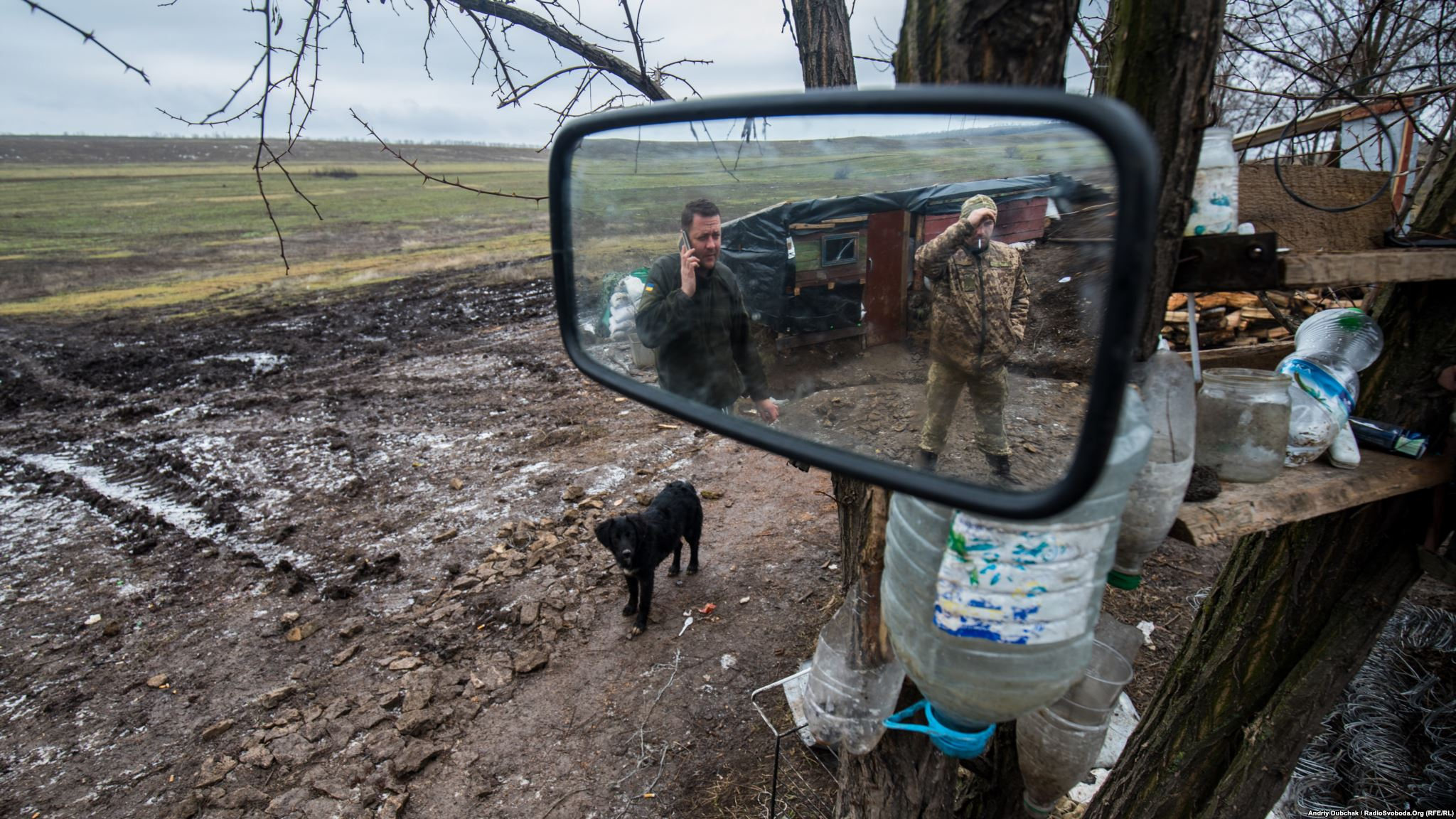 Puppy on position. Mirror and inverted bottles form a summer washstand. (photo by ukrainian military photographer Andriy Dubchak)