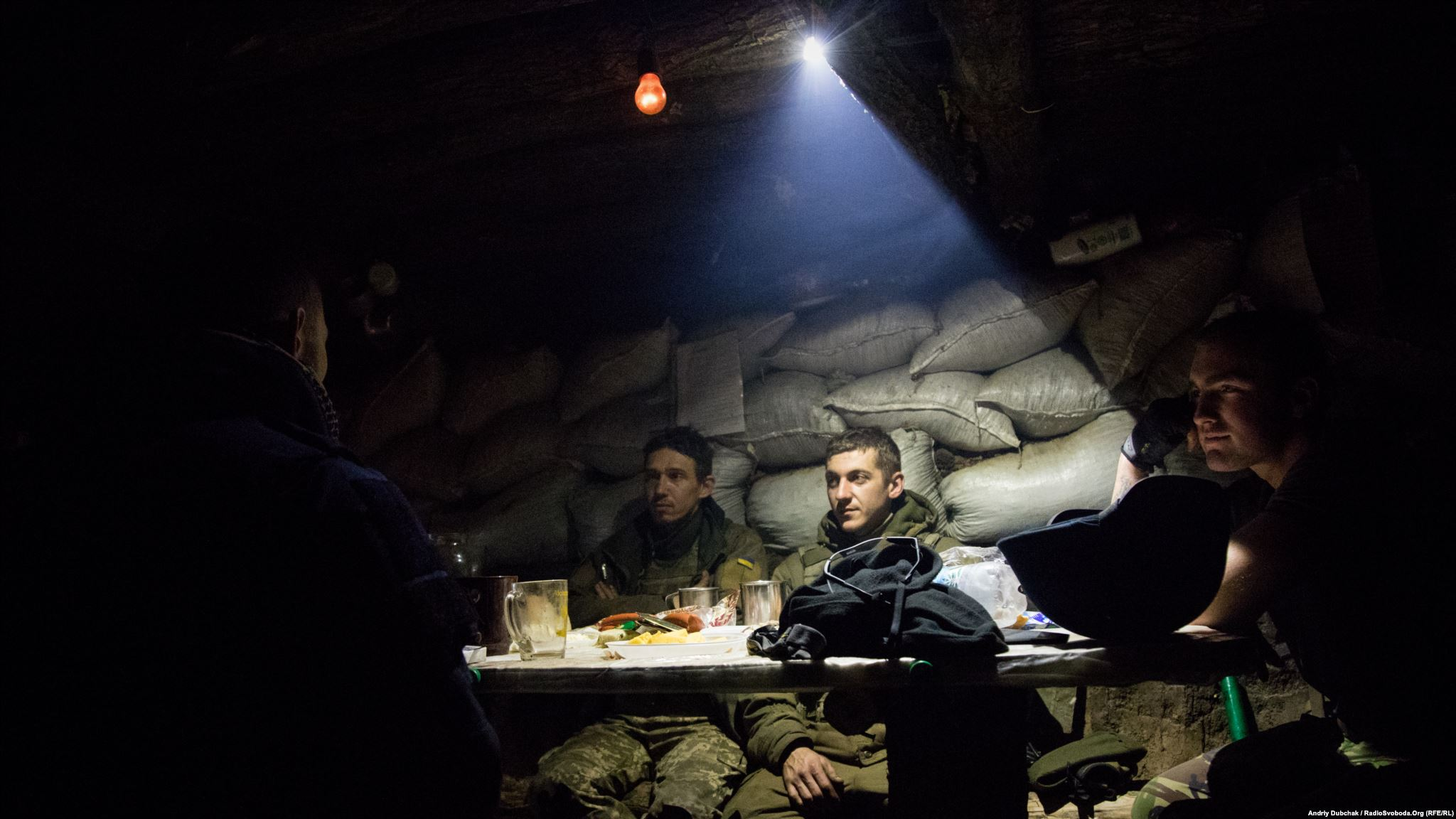 Supper during engagement, near Popasna. Some Ukrainian military eat dinner, while others suppress enemy fire (photo by ukrainian military photographer Andriy Dubchak)